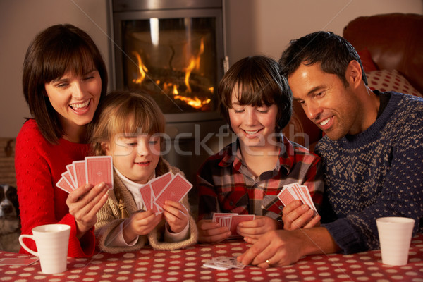 Portrait Of Family Playing Cards By Cosy Log Fire Stock photo © monkey_business
