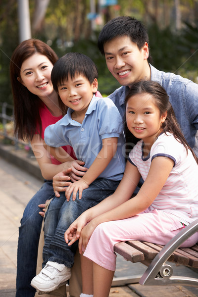 Chinese Family Walking Sitting On Bench In Park Together Stock photo © monkey_business