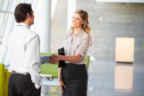 üzletember üzletasszony kézfogás iroda üzlet férfi Stock fotó © monkey_business