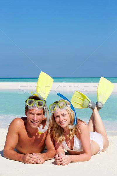 Couple With Snorkels Enjoying Beach Holiday Stock photo © monkey_business