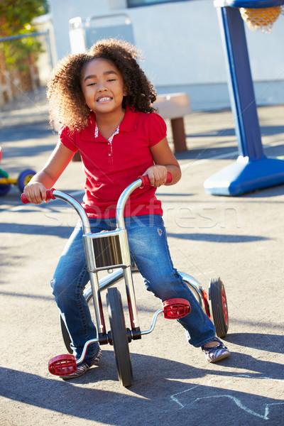 çocuk binicilik üç tekerlekli bisiklet oyun alanı kız mutlu Stok fotoğraf © monkey_business