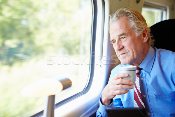üzletember megnyugtató vonat csésze kávé férfi Stock fotó © monkey_business