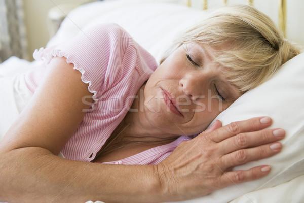 Woman lying in bed sleeping Stock photo © monkey_business