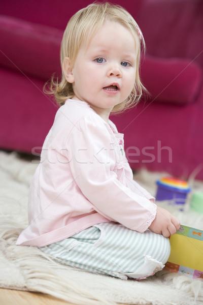 Baba nappali játékok könyv lány gyermek Stock fotó © monkey_business