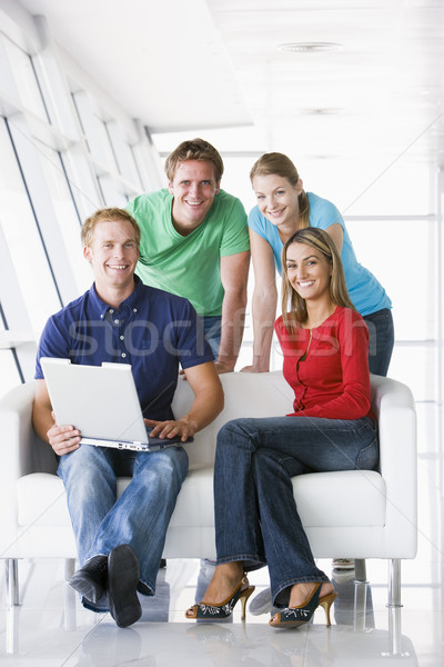 Quatre personnes lobby portable souriant équipe parler Photo stock © monkey_business