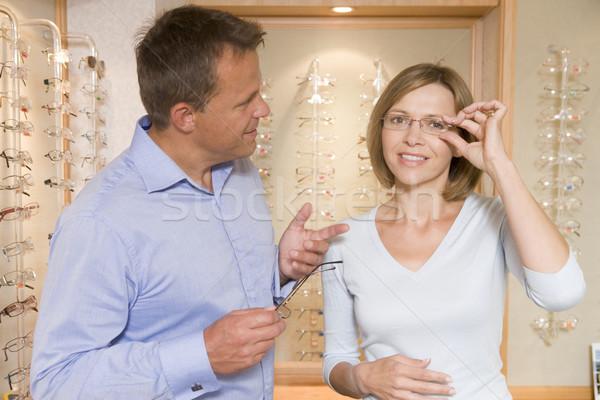 Couple trying on eyeglasses at optometrists smiling Stock photo © monkey_business