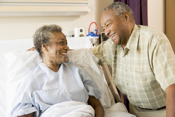 Stock photo: Senior Couple Smiling At Each Other In Hospital