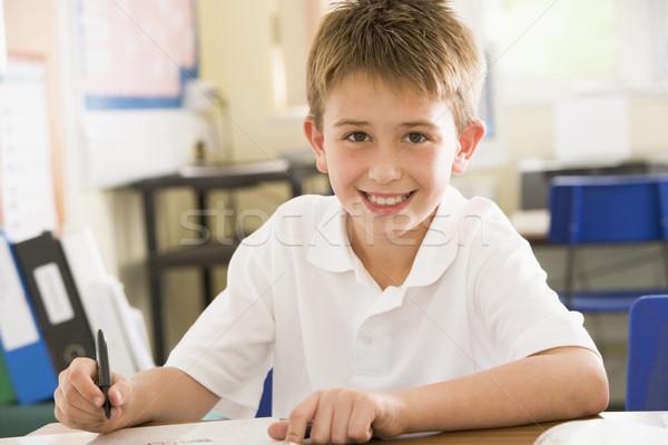Estudante estudar classe escrita retrato secretária Foto stock © monkey_business