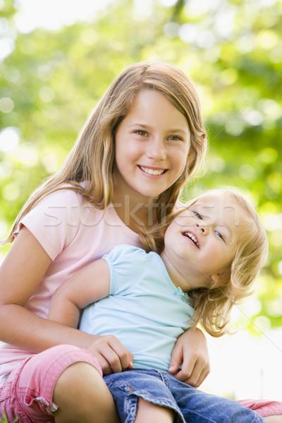 Deux soeurs séance extérieur souriant enfants Photo stock © monkey_business