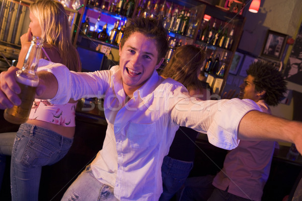 Young man in nightclub approaching camera with arms outstretched Stock photo © monkey_business