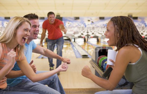 Quattro giovani adulti bowling donna sport Foto d'archivio © monkey_business