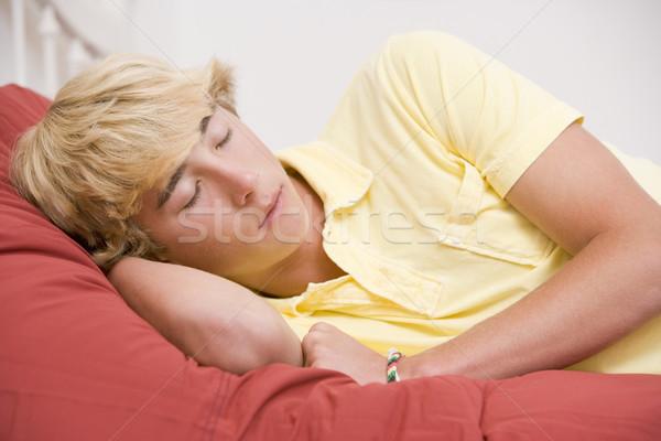 Lit adolescent chambre dormir fatigué Photo stock © monkey_business