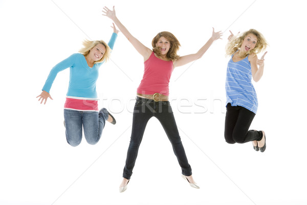 Saltando ar cor adolescentes horizontal Foto stock © monkey_business