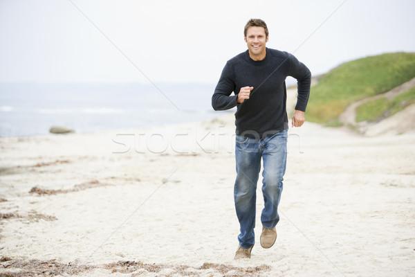Man running at beach smiling Stock photo © monkey_business