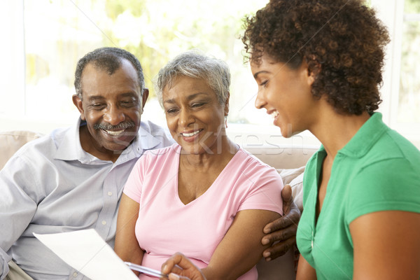 Praten financieel adviseur home vrouw paar Stockfoto © monkey_business