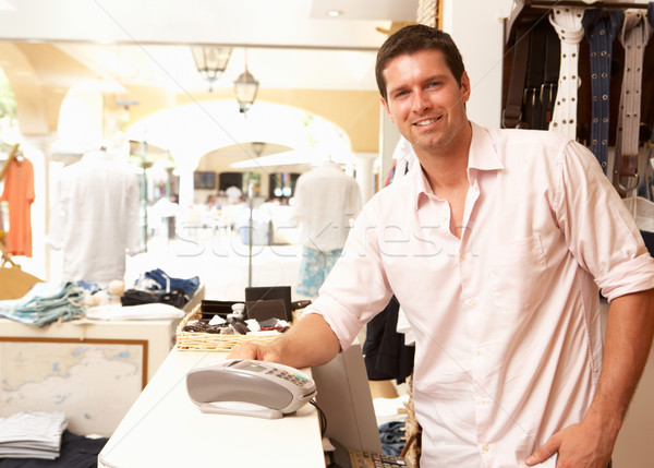 Male Sales Assistant At Checkout Of Clothing Store Stock photo © monkey_business
