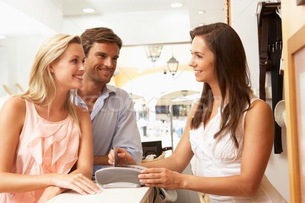 Női eladó asszisztens pénztár ruházat bolt Stock fotó © monkey_business