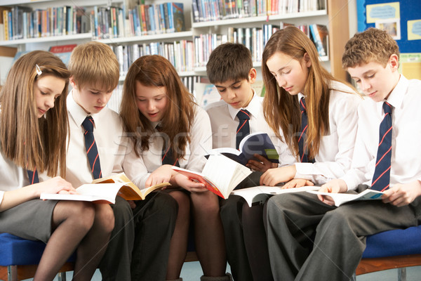 Teenage Students In Library Reading Books Stock photo © monkey_business