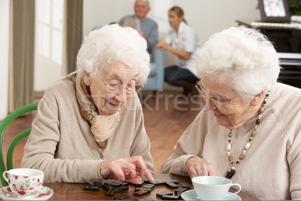 Two Senior Women Playing Dominoes At Day Care Centre Stock photo © monkey_business