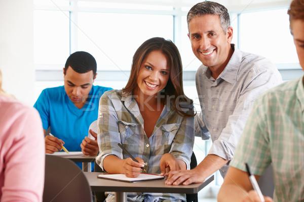 Aiutare studente classe donne istruzione Foto d'archivio © monkey_business