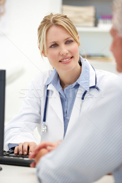 Young doctor with senior patient Stock photo © monkey_business