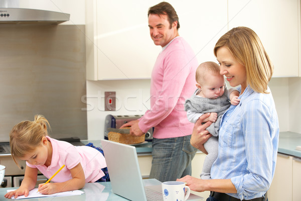 Family busy together in kitchen Stock photo © monkey_business
