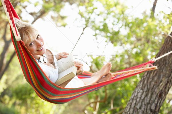 Senior Woman Relaxing In Hammock Stock photo © monkey_business