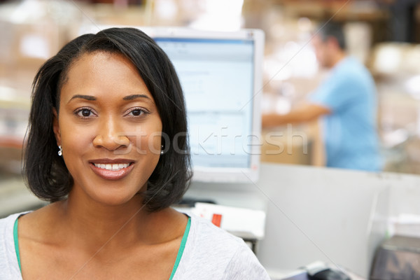 Woman At Computer Terminal In Distribution Warehouse Stock photo © monkey_business