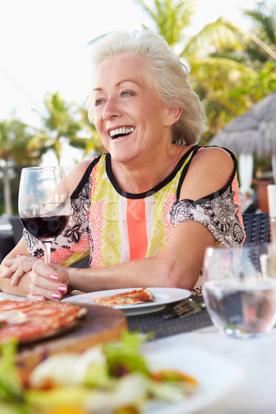 Stock photo: Senior Woman Enjoying Meal In Outdoor Restaurant