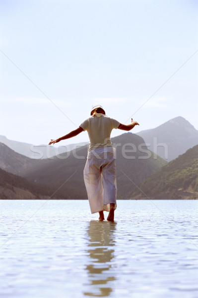 Young woman walking in lake Stock photo © monkey_business