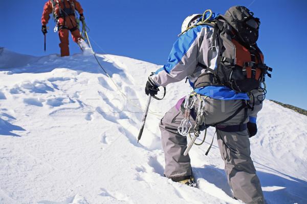 Genç erkekler dağcılık erkekler takım mavi gökyüzü Stok fotoğraf © monkey_business