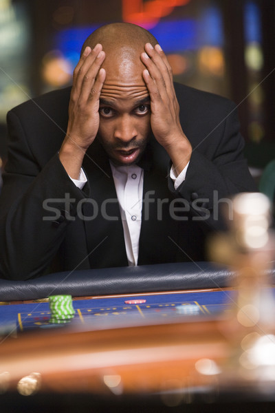 Man losing at roulette table Stock photo © monkey_business