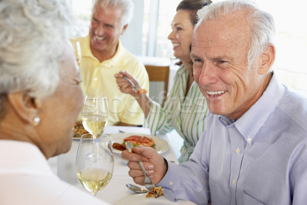 Stock photo: Friends Having Lunch Together At A Restaurant