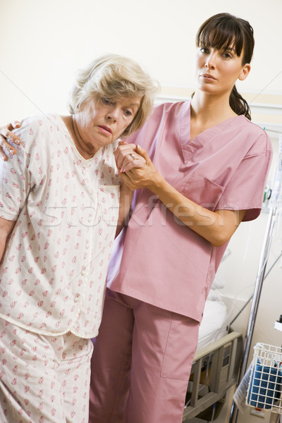 Stock photo: Nurse Helping Senior Woman To Walk