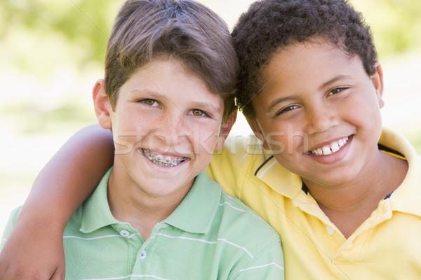 Stock fotó: Kettő · fiatal · férfi · barátok · kint · mosolyog