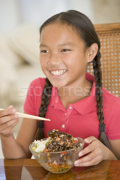 Young girl in dining room eating chinese food smiling Stock photo © monkey_business