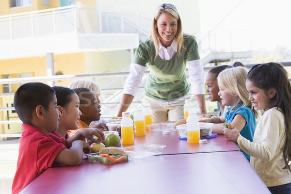 Сток-фото: детский · сад · учитель · детей · еды · обед · студент