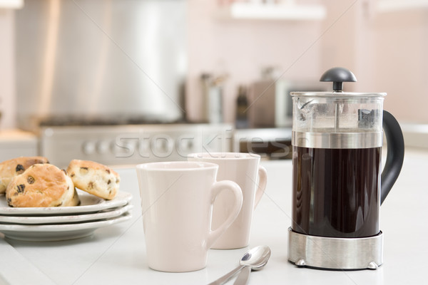 Coffee pot on kitchen counter with scones Stock photo © monkey_business