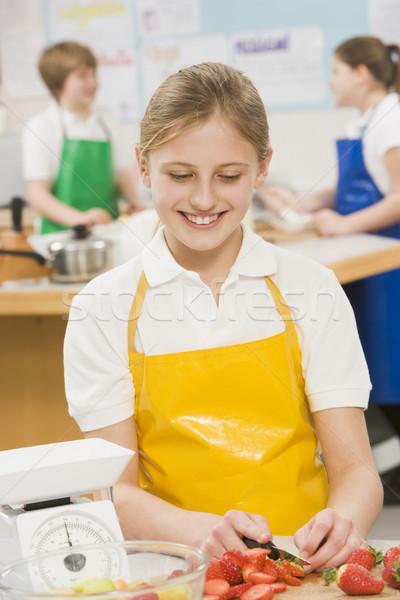 Stock photo: Schoolgirl at school in a cooking class