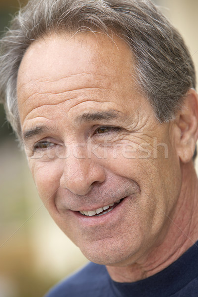 Stock photo: Portrait Of Middle Aged Man Smiling