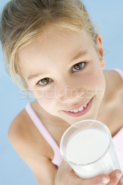 Young girl with glass of milk smiling Stock photo © monkey_business