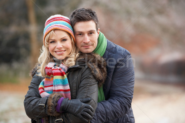 Couple On Romantic Winter Walk Through Frosty Landscape Stock photo © monkey_business