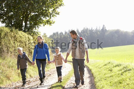 Young couples on country walk Stock photo © monkey_business