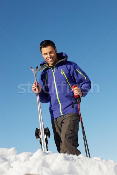 Középkorú férfi sí ünnep hegyek boldog hó Stock fotó © monkey_business