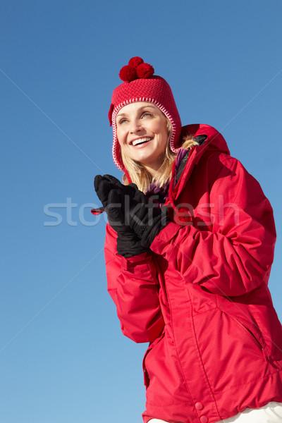 женщину Постоянный снега одежды Сток-фото © monkey_business