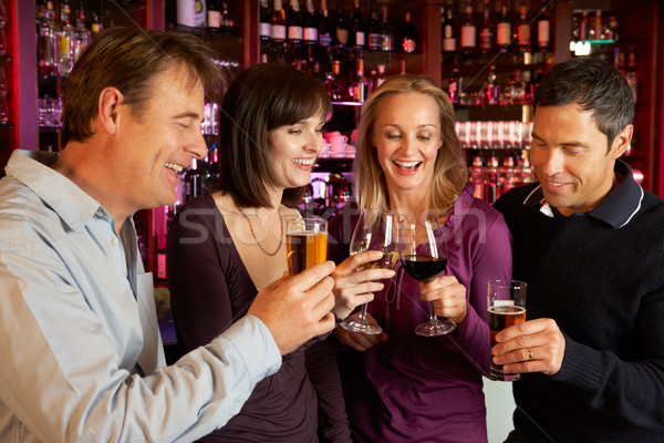Group Of Friends Enjoying Drink Together In Bar Stock photo © monkey_business