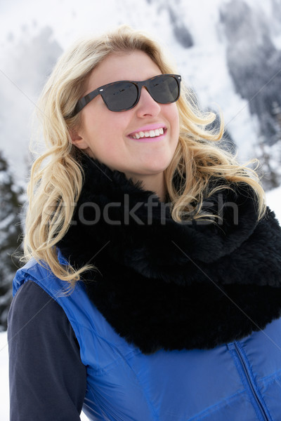 Young Woman On Ski Holiday In Mountains Stock photo © monkey_business