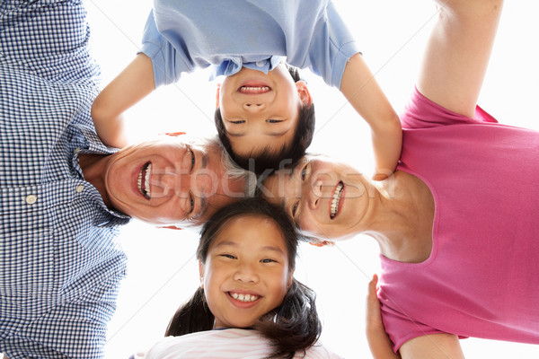 Chinese Grandparents With Grandchildren Looking Down Into Camera Stock photo © monkey_business