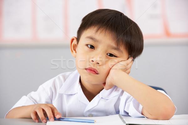 Unglücklich männlich Studenten arbeiten Schreibtisch chinesisch Stock foto © monkey_business