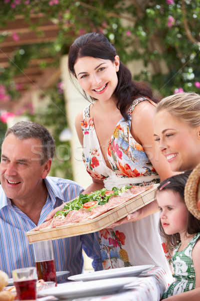 Woman Serving At Multi Generation Family Meal Stock photo © monkey_business